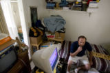 Fred Abrey(cq) sits in his 10 foot by 10 foot room in Arvada, Colorado on Thursday, July  12,...