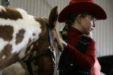 Kendra Torgerson(cq), 11, from Broomfield, waits with her Welsh horse Rocky for their turn in the...