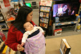 MJM053 Braving one of the busiest shopping days of the year, Valerie Sandoval (cq) of Denver,...