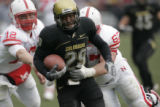 0850 University of Colorado #29 Cha'pelle Brown reterns an interception in the fourth quarter...