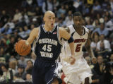NVJH114 - Brigham Young's Jonathan Tavernari(45) drives past Louisville's Earl Clark(5) during the...