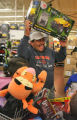 Jose Ramirez (cq) had a big smile when he found  a toy Jeep for one of his children  at the...