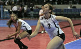 Laura Brodie, right, goes for the ball, while teammate Jill Tomma, both from Cheyenne Mountain,...