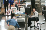DM0323   A TSA workers smiles as he screens passengers at Denver International Airport in Denver,...
