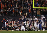[EPS101] Chicago Bears tackle John Tait signals a touchdown for the Bears in the fourth quarter of...