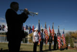 DM0694   Bill Davis with the Littleton Community Music Association plays his trumpet as the colors...