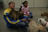 John Parent-Sabett, 17 and his sister Luisa Parent-Sabett, 12 get to know puppies Monday Nov. 26,...