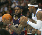 LeBron James drives against Carmelo Anthony in the first period of the Denver Nuggets against the...