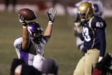 Douglas County's Ryan Misare, left, holds up the ball he intercepted with seconds to go in the...