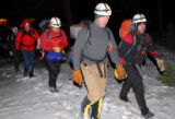 Rescue workers from Rocky Mountain Rescue Group and Rocky Mountain National Park hike to the...