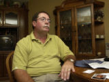 (BEATRICE, Nebraska, September 8, 2004) Nile E. Dragoo, family spokesman, answers questions at an...