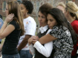 Rylie Thordsen (cq) right , in black, from Standley Lake High School hugs her mother Robin...