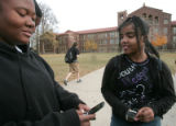 Sonja Harley , left, a student at South High School in Denver,  text messages a friend after...