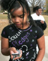 Raquel Robertson(cq) a student at South High School in Denver,  text messages a friend after...