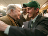 TXDL102 - Former Houston football coach Art Briles, right, is greeted by a former Baylor football...