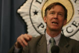 Mayor John Hickenlooper, speaks to reporters Wednesday Nov. 14, 2007 during a press conference...