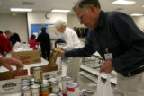 Retired Allendale Elementary  principle, Tom Trembath, cq, packs a bag of food, Thursday Nov. 15,...
