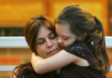 Megan Bomgaars (cq), 14, gives a hug to her mom Kris Bomgaars (cq), while at cheerleading practice...