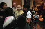 Tom Smedley and Jane Smedley chat with students from Smedley Elementary Sch. before the start of...