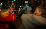 (JOE302) Dayton Murray, 13, left, of Denver (CQ) high fives  through his sleeping bag  a...