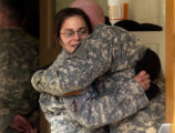 SPC jennelle Slaughter, left, gives SSG Rolin Hansperger a hug after a memorial service Friday,...