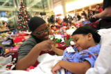 DM0919   D'Marus Brice, 4, of Colorado Springs smiles as he plays with his mother Tesa Brice as...