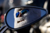 DM0517   Rich Decino, 48, of Arvada keeps his face warm behind a Santa Claus beard as he gets...