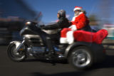 DM0876   Bikers decked out in holiday gear leave Highlands Ranch headed to The Children's Hospital...