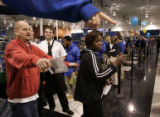 Best Buy employee Kevin Latchford (cq) tells co-worker Carol Wamalwa (cq) that she is being...