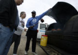 Jim Sullivan, of Big Jim's Ribs mobil van in Parker, shows Evelyn and Fritz Schaudies (cq), of...