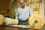 (9/23/2004 DENVER, Colorado) Rabbi Adam Morris of Temple Micah rolls the Torah to Leviticus for a...