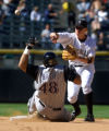 (DENVER, Co., SHOT 9/23/2004) The Colorado Rockies' Clint Barmes (#12, SS) turns a double play in...