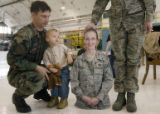 DM0386   Jarret, 21 months, stands in between his father Master Sgt. J.T. and a cutout of his...