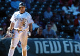 (DENVER, Co., SHOT 9/23/2004) The Colorado Rockies' Aaron Miles (#6) is one of a number of rookies...