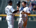 (DENVER, Co., SHOT 9/23/2004) The Colorado Rockies' Aaron Miles (#6) gets a few pointers from base...