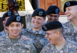 DM3171   Pfc. Matt Vitug, center, puts his hand on the shoulder of Pfc. Mike Fuentez as he teases...