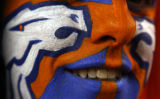 [EPS101] Brian Kellan (cq), 28, of Parker, Colo., shows his Bronco pride during pre-game before...