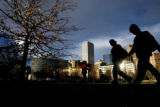 DM0370   Pedestrians walk through the southwest section of Civic Center Park near where a new...