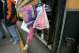 0053 Janae Cashman, 8, carries a bag of food she received through the Feeding the Future Program...