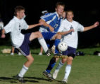 (DENVER, COLO., SEPTEMBER 23, 2004) - Mullen's #7, Travis Noble, left, and #5, Adam Horecki,...