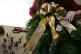 8. How to make a wreath with Denise Capelli at Capelli Floral:  Add the bow with wire.  (JUDY...