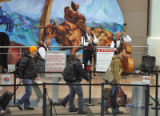 Members of the Dixieland Express, play as travelers pass through security screening at Denver...