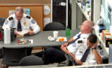 TSA workers get some rest during a quick break from security screening at Denver International...