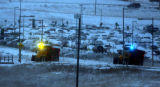 Snowplows work at the entrance to  at Denver International Airport  parking  early Wednesday...