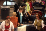 Passengers  pass through security screening at Denver International Airport  with less than a ten...