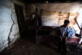 (NYT16) PINGGAO, China -- Nov. 18, 2007 -- CHINA-DAM-2 -- Tan Zhenyou in the bedroom of her home...
