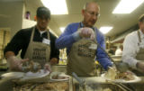 Jeremy Bloom and Rep. Joel Judd D-Denver, help  serve a Thanksgiving lunch to low-income and...