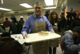 Gov. Ritter helps serve a Thanksgiving lunch to low-income and homeless families Wednesday Nov....