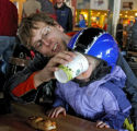 Matt Wenger (cq) helps his two year old daughter, Hannah Wegner, drink some soup, during a lunch...