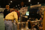 Ed Dentry/Rocky Mountain News Exhibitors and visitors talk fishing at The Fly Fishing Show in...